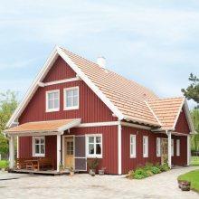 Jahrhunderte alte Techniken und Know-how aus dem nordischen Niedrigenergiehausbau. Ein Kreiseder Naturmaßhaus™, realisiert als Wohntraum in Schwedenrot.